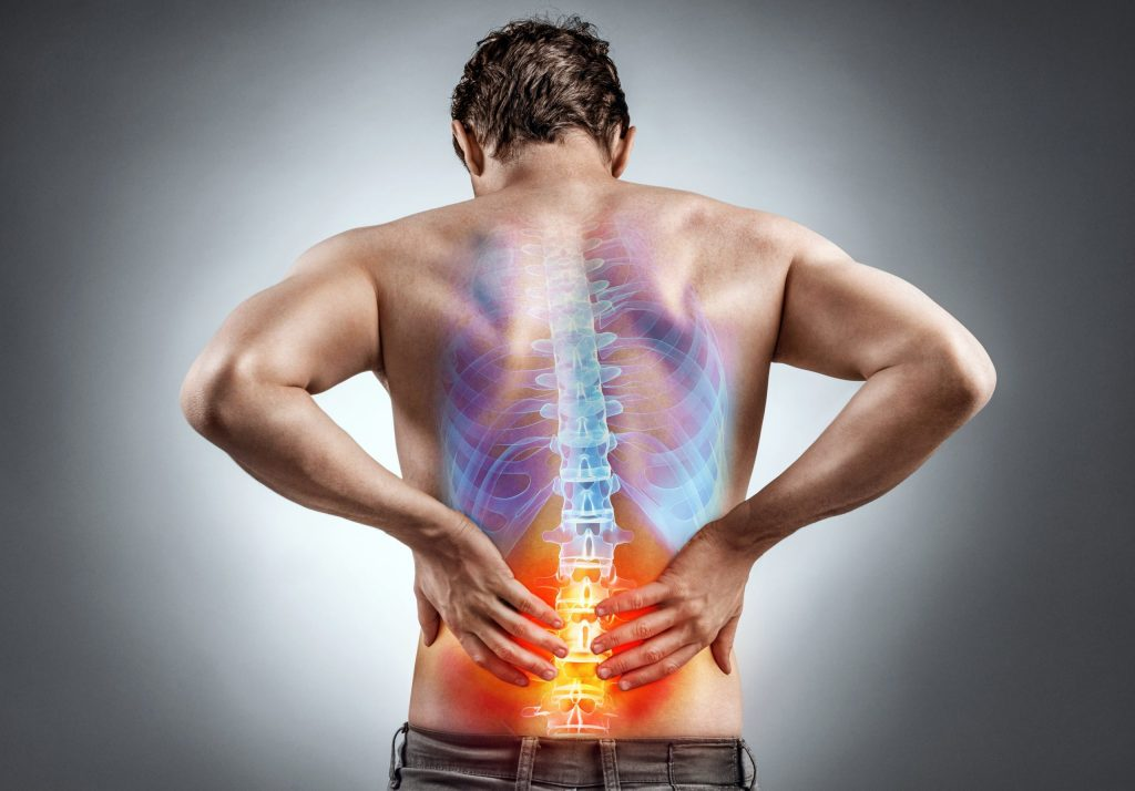 back view of man with colorful spine graphic on lower back indicating pain