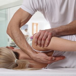 therapist working on female patient's back