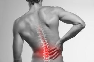 view of male back with spine graphic indicating pain