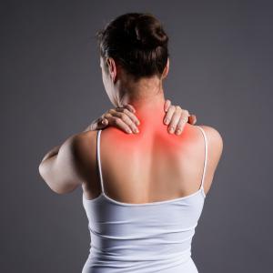 back view of woman grabbing shoulders