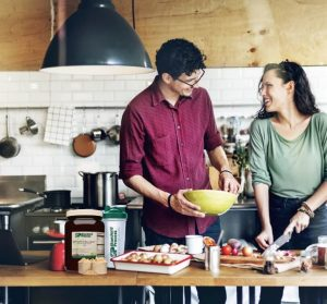 a couple in their kitchen cooking with Standard Process