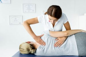 female chiropractor giving treatment